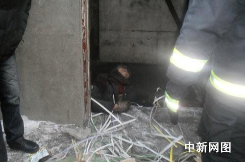 哈尔滨一捡废品女子被从上而下电梯夹死(图)